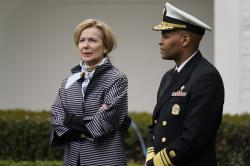 Dr. Deborah Birx, White House coronavirus response coordinator and Surgeon General Jerome Adams arrive for a Fox News Channel virtual town hall at the White House, Tuesday, March 24, 2020, in Washington. (AP Photo/Evan Vucci)