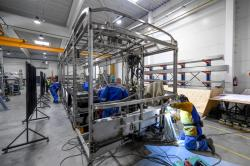 Employees of the Hungarian bus maker ITK Holding work at the plant in Debrecen, Hungary, Thursday, April 09, 2020