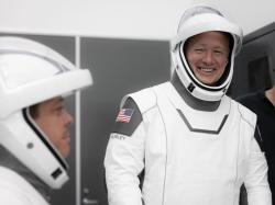 This Thursday, March 19, 2020 photo made available by SpaceX shows NASA astronauts Bob Behnken and Doug Hurley during flight simulator testing at the Kennedy Space Center in Cape Canaveral, Fla.