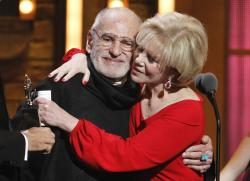 """Larry Kramer, left, and Daryl Roth embracing after they won the Tony Award for Best Revival of a Play for """"The Normal Heart"""" during the 65th annual Tony Awards in New York."""