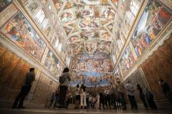 Visitors admire the Sistine Chapel as the Vatican Museum reopened, in Rome, Monday, June 1, 2020.