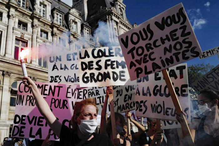 Women's rights activists protest against French President Emmanuel Macron's appointment of an interior minister who has been accused of rape and a justice minister who has criticized the #MeToo movement, in front of Paris city hall, in Paris, France