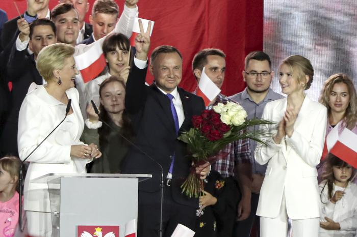 Incumbent President Andrzej Duda flashes a victory sign in Pultusk, Poland.