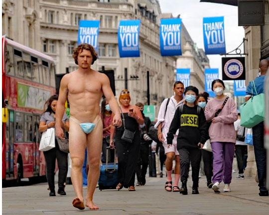 Tim Shieff walks through London in a G-string on Friday, July 24, 2020