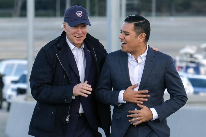 Democratic presidential candidate Joe Biden, left, and Long Beach Mayor Robert Garcia arrive during a tour of the Gerald Desmond Bridge Replacement Project in Long Beach, Calif.