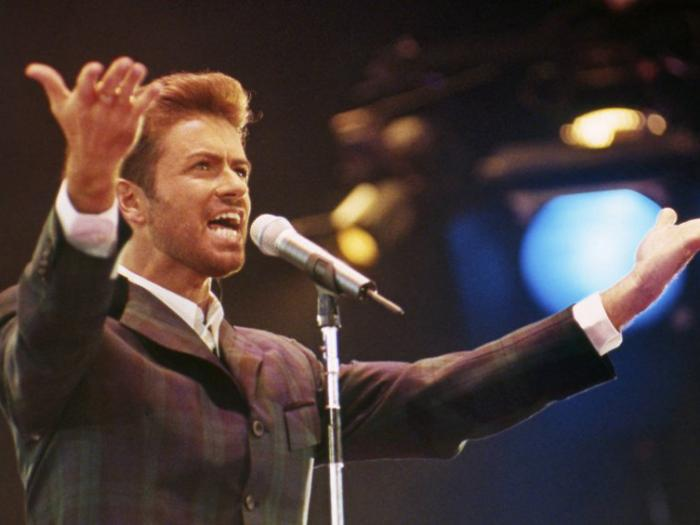 """In this Dec. 2, 1993 file photo, George Michael performs at """"Concert of Hope"""" to mark World AIDS Day at London's Wembley Arena"""