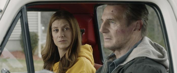 "Kate Walsh, left, and Liam Neeson in a scene from ""Honest Thief."""