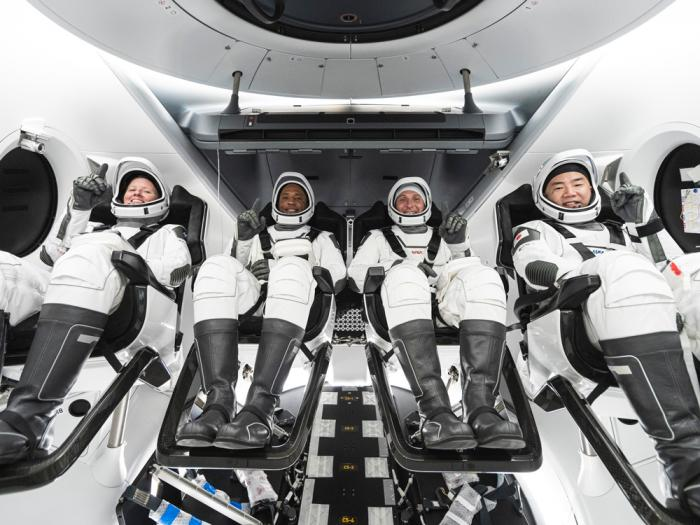 This undated photo made available by SpaceX in September 2020 shows, from left, NASA astronauts Shannon Walker, Victor Glover, and Mike Hopkins, and Japan Aerospace Exploration Agency astronaut Soichi Noguchi inside SpaceX's Crew Dragon spacecraft