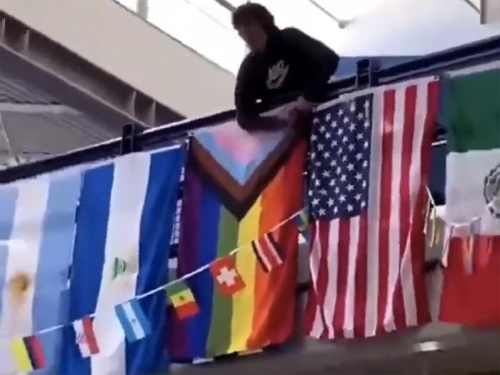 This screencap from video shared widely online shows a student cutting down a Proide flag at Ridgeline High School on April 13