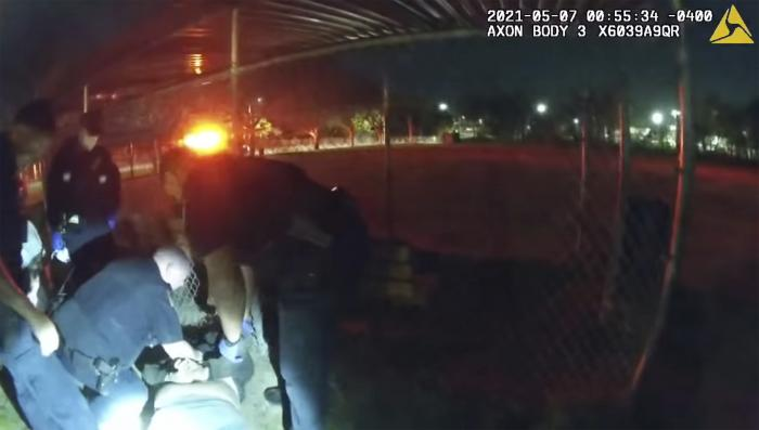 This photo taken from Providence Police body camera shows officers responding to a call Friday, May 7, 2021 of a man who was screaming outside in Providence, R.I.