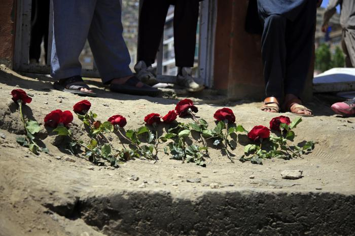 People puts flowers outside a school after a deadly attack on Saturday, in Kabul, Afghanistan, Sunday, May 9, 2021.