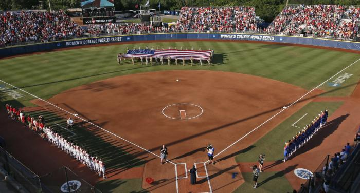 large flag is unfurled in the outfield before the second game of the best-of-three championship series between Florida and Oklahoma in the NCAA Women's College World Series in Oklahoma City.