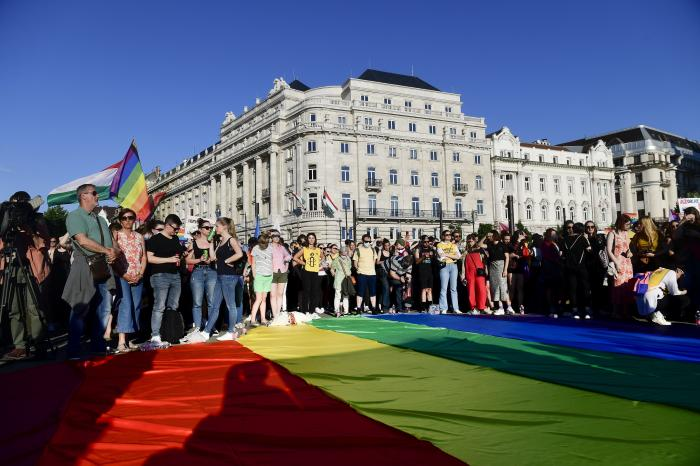 People unfurl a rainbow flag during an LGBT rights demonstration in front of the Hungarian Parliament building in Budapest, Hungary.