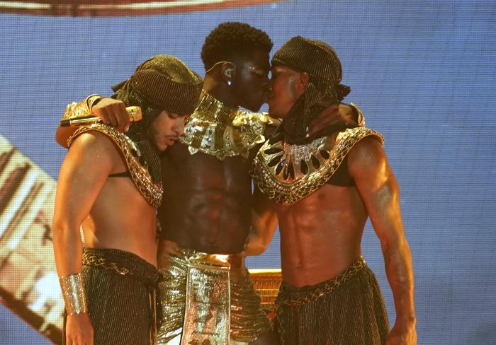 Lil Nas X, center, kisses a dancer at the conclusion of his performance at the BET Awards on Sunday.