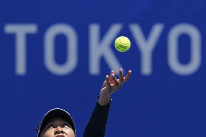 Naomi Osaka, of Japan, practices for the women's tennis competition ahead of the 2020 Summer Olympics.