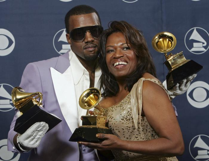 Kanye West and his mother, Donda, hold his three awards backstage at the 48th Annual Grammy Awards in Los Angeles in 2006.