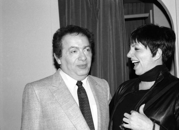 In this Feb. 4, 1991, file photo, Liza Minnelli chats with comic Jackie Mason during a visit backstage at the Neil Simon Theater in New York.