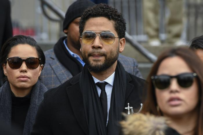 """In this Feb. 24, 2020 file photo, former """"Empire"""" actor Jussie Smollett leaves the Leighton Criminal Courthouse in Chicago."""