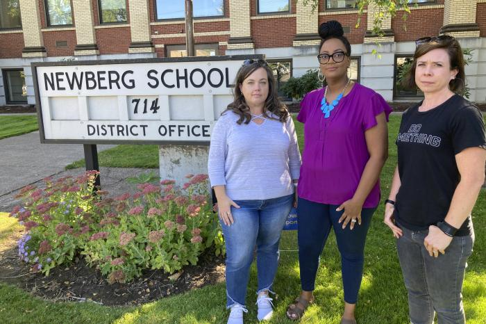 From left, Beth Woolsey, Tai Haden-Moore and AJ Schwanz , who are members of a group called Newberg Equity in Education.